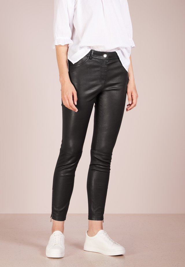 ETTY - Leather trousers - black