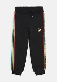Puma - WORLDHOOD TRACK PANTS  - Tracksuit bottoms - black - 0