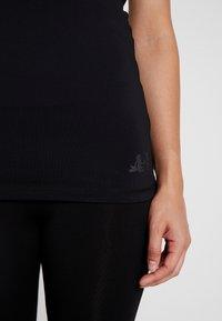 Curare Yogawear - TANK - Débardeur - black - 5