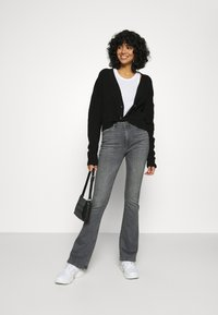 ONLY - ONLPAOLA FLARED JEANS - Flared Jeans - black denim - 1
