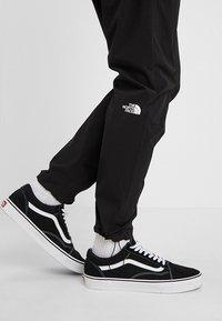The North Face - TECH PANT - Spodnie treningowe - black/white - 3
