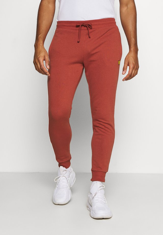 WITH CONTRAST PIPING - Tracksuit bottoms - terracotta orange