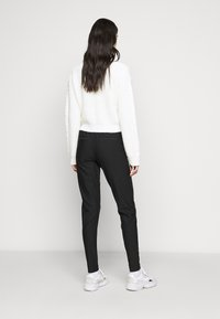 ONLY Tall - ONLPOPTRASH PINSTRIPE FRILL PANT - Trousers - black/white - 2