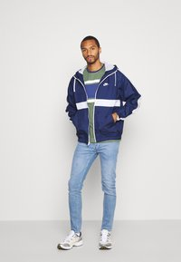 Topman - POWDR MASON  - Slim fit jeans - blue - 1