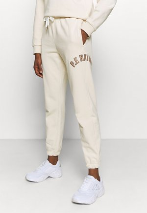 DROP SHOT TRACK PANT - Tracksuit bottoms - pearled ivory