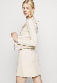 NU-IN - STEFANIE GIESINGER X nu-in CUT OUT LONG SLEEVE MINI DRESS - Shift dress - beige - 4