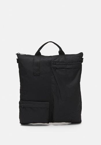 POCKET TRAVEL BAG - Tote bag - black