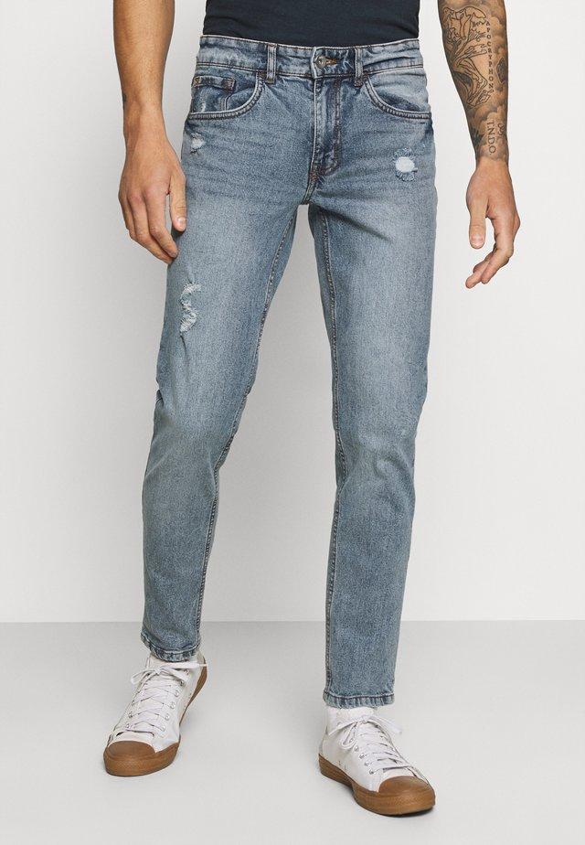 STOCKHOLM DESTROY - Slim fit jeans - crystal blue