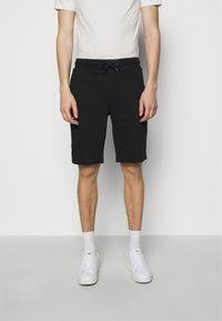 Emporio Armani - BERMUDA - Shorts - black - 0