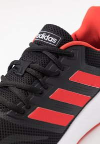 adidas Performance - RUNFALCON - Neutral running shoes - core black/active red/core black - 5