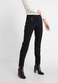 Bogner - LINDY - Spodnie materiałowe - black - 0