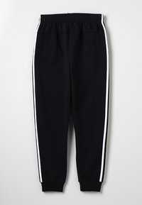 adidas Performance - Tracksuit bottoms - black/white - 1