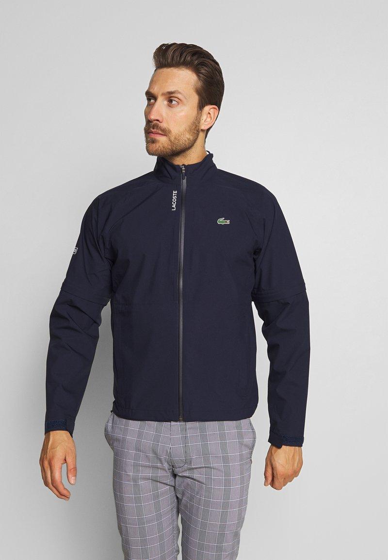 Lacoste Sport - HIGH PERFORMANCE JACKET - Waterproof jacket - navy blue/white