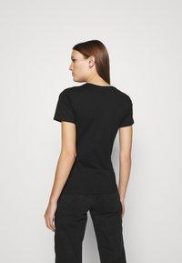 Calvin Klein Jeans - MONOGRAM TEE - Print T-shirt - black - 2