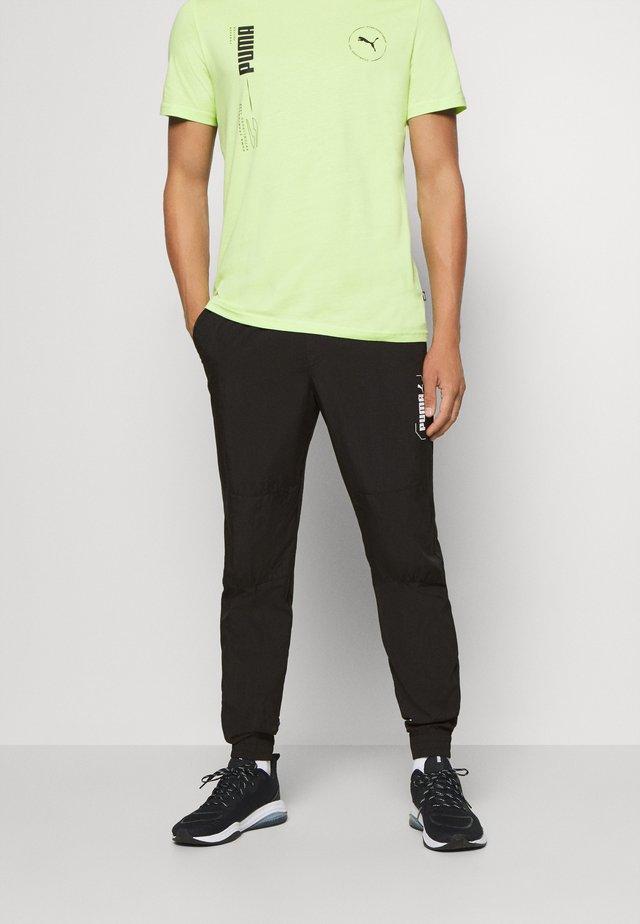NUTILITY PANTS - Spodnie treningowe - black
