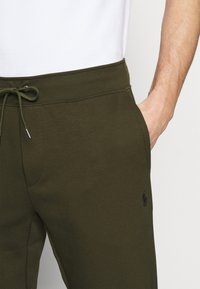 Polo Ralph Lauren - Tracksuit bottoms - company olive - 3