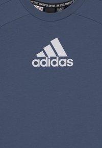 adidas Performance - UNISEX - T-shirt print - creblu/white - 2