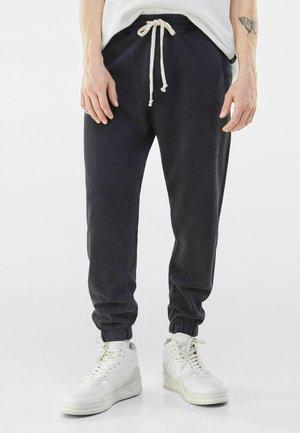 PLUSH COSY - Pantaloni sportivi - black