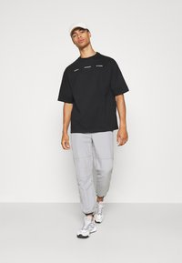 Holzweiler - RANGER TEE - Print T-shirt - black - 1