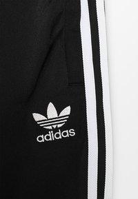adidas Originals - SUPERSTAR PANTS - Trainingsbroek - black/white - 4