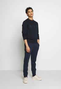 Michael Kors - Tracksuit bottoms - midnight - 1