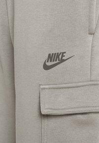 Nike Sportswear - PANT - Tracksuit bottoms - light army/cargo khaki - 5