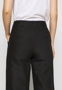 DESIGNERS REMIX - HAILEY FLARE - Trousers - black - 6