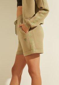 Guess - LOGODREIECK - Sports shorts - beige - 3
