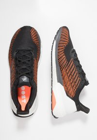 adidas Performance - SOLAR BOOST ST 19 - Stabilty running shoes - core black/grey five/solar orange - 1