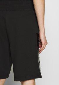Versace Jeans Couture - LOGO - Pantalon de survêtement - black - 3