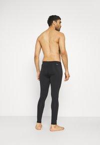 New Balance - ACCELERATE - Leggings - black - 4