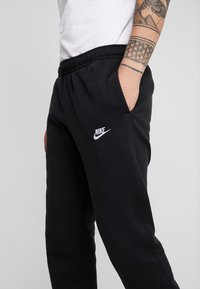 Nike Sportswear - CLUB PANT - Tracksuit bottoms - black - 4