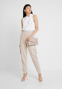 Missguided - UTILITY POCKET HIGH WAISTED - Tracksuit bottoms - nude - 1