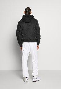 Lacoste Sport - PREMIUMI JACKET - Winter jacket - black - 2