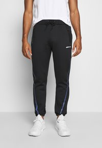 Ellesse - ROMANO - Tracksuit bottoms - black - 0
