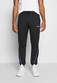 Ellesse - ROMANO - Teplákové kalhoty - black - 0