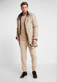 adidas Performance - Pantalones deportivos - tan - 1