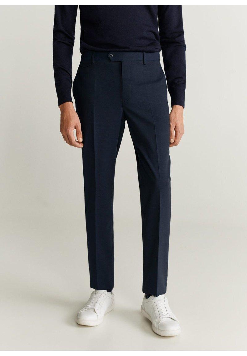 Mango - TRAVEL - Suit trousers - dunkles marineblau