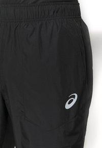 ASICS - CORE PANT - Tracksuit bottoms - performance black - 5