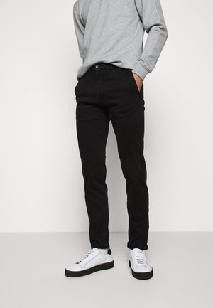 STEEN - Trousers - black