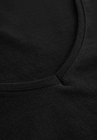 ORSAY - Basic T-shirt - schwarz - 4