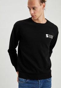 DeFacto - Stickad tröja - black - 3