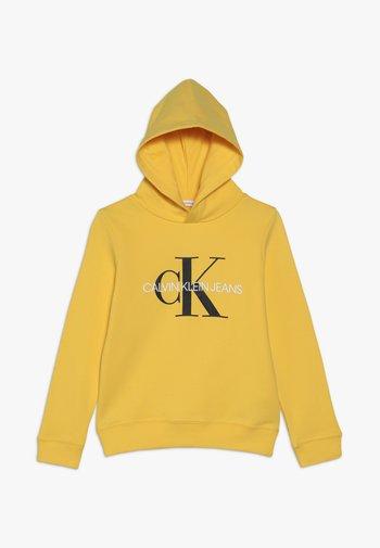 MONOGRAM HOODIE UNISEX - Kapuzenpullover - yellow