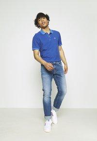Tommy Jeans - GARMENT DYE - Polo shirt - blue - 1