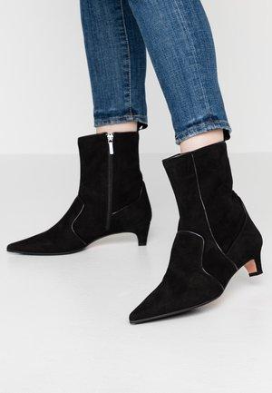 SANDRA - Classic ankle boots - nero
