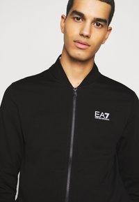 EA7 Emporio Armani - Zip-up hoodie - black - 3
