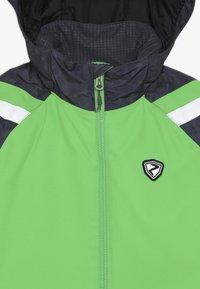 Ziener - AVER JUNIOR - Ski jacket - green - 2