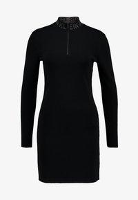 Calvin Klein Jeans - NECK LOGO FITTED DRESS - Pouzdrové šaty - black - 4