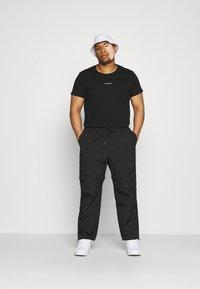 Calvin Klein Jeans Plus - PLUS MICRO BRANDING - Print T-shirt - ck black - 1