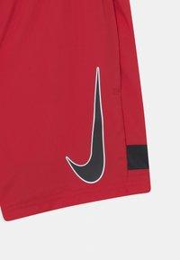 Nike Performance - ACADEMY UNISEX - Urheilushortsit - gym red/black - 2